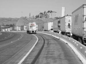 Integrated transportation truck passing other trucks